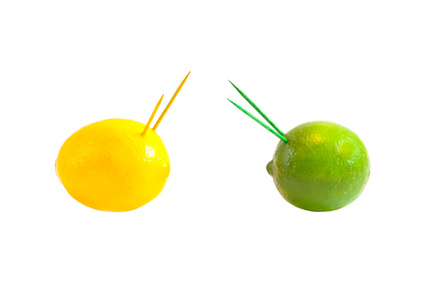 Concept of war or fighting. Lemon and lime against each other